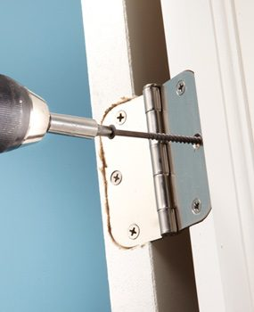 One way to fix a sagging or sticking door is to draw it in with a 3-in. screw.