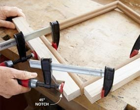 Make special clamping blocks to tighten miter joints.
