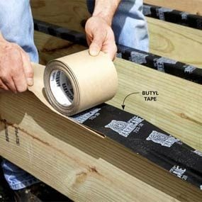 Lay butyl tape over the joist tops to help prevent rot.