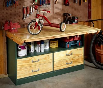 Fold-up garage workbench with top in up position