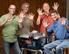 Four table saw testers displaying their hands with no missing fingers to show that the safety features work.