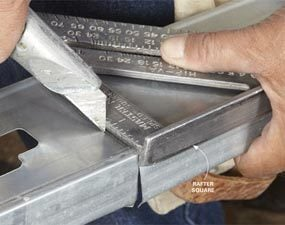 Scoring a steel stud with a utility knife