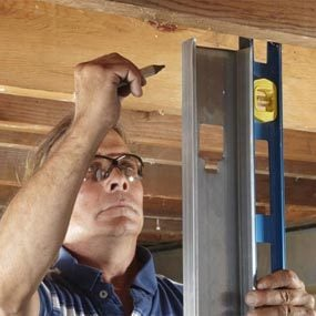 Stud with level to establish a plumb wall