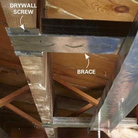 Track sections span joist spaces to support ceiling plate