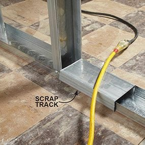 Track scrap covers sharp edges of floor track