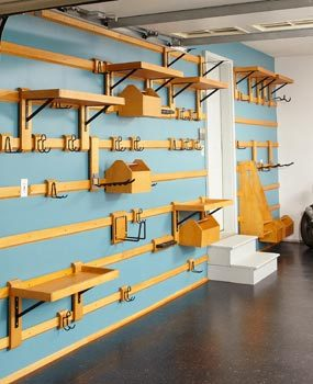 Customizable garage storage system wall wood strips and hangers