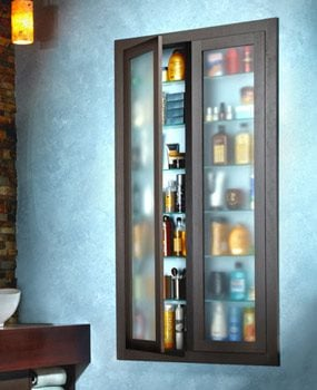 Two boxes of built-in shelves joined together and covered by glass doors.