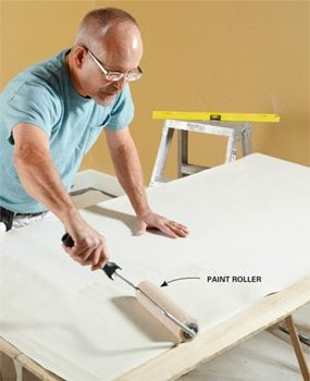 Apply paste with a paint roller