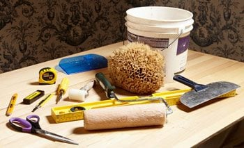 A variety of tools used to hang wallpaper.
