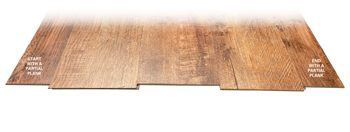Three full-width planks of luxury vinyl flooring flanked by planks of cut-down widths.