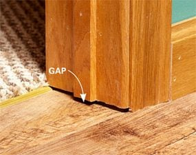Photo showing the gap between a new floor and the bottom of a doorjamb.