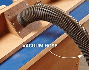 Dust collection attached to a router table.