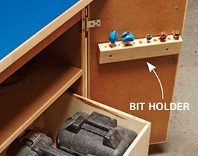 Router table storage drawer and bit holder.