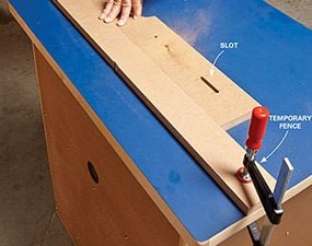 Cutting slots into the router table fence.