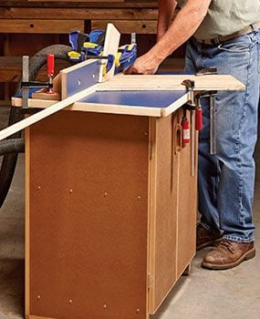 Diy router table plans the family handyman cutting a long workpiece on a router table greentooth Choice Image