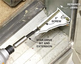 Mounting a screen door closing bracket with 3-in. screws when repairing a screen door.