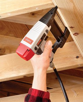Using a finish nailer to install tongue-and-groove boards.