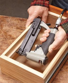 Using a pin nailer to fasten workpieces in a tight space.