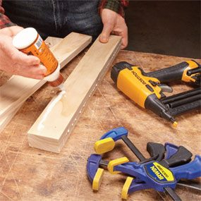 Using a brad nailer to hold glued workpieces together before clamping.