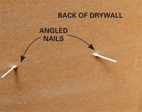 Angled finish nails in drywall with no studs.