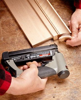 Fastening a tiny workpiece with a pin nailer.