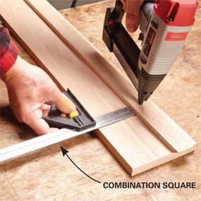 Using a gauge to place workpieces when using a finish nailer.