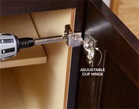 Screw the hinge to the cabinet stile.