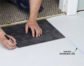 Mark the first tile location for your luxury vinyl tile installation.