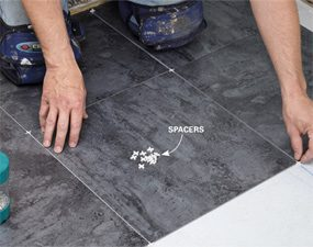 A luxury vinyl tile installation looks best if tile spacers are used to keep the grout lines even.