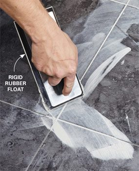 To finish a luxury vinyl tile installation, spread the recommended grout into all the joints, then wipe clean.