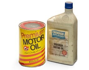 An old bottle of oil and and an old can of oil.