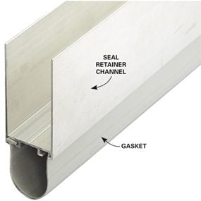 Slide a section of retainer and gasket onto the bottom edge of the garage door. Tilt it until the rubber gasket touches the concrete floor. Then screw the retainer in place.
