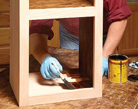 Apply finish to the inside of the face frame cabinets before you put the backs on.