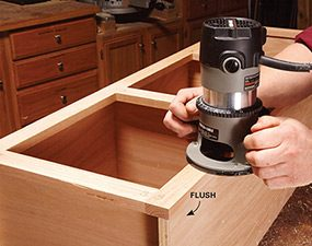 Trim the face frames to fit the cabinet boxes with a flush trim router bit.
