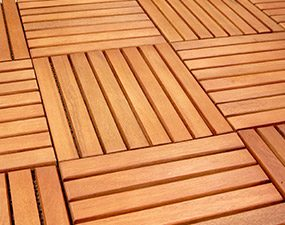 Interlocking plastic tiles are another alternative to a wood deck over a concrete patio.