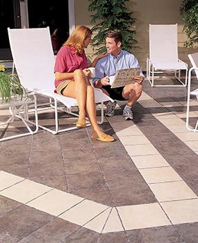 You may be able to cover the existing concrete patio with ceramic tile.
