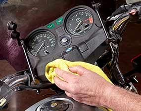Clean and polish the motorcycle dash as part of the detailing.