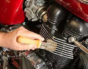 Clean the engine and drivetrain when detailing a motorcycle.