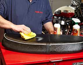 Keep the motorcycle seat in good condition by cleaning and conditioning it as you're detailing.