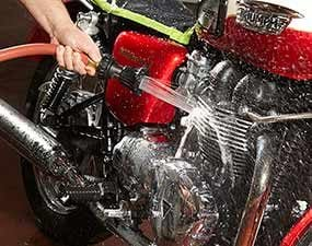 Rinse off the motorcycle after cleaning and detailing.
