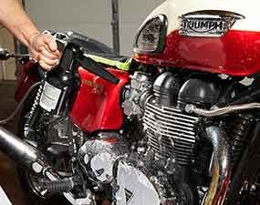 Blow dry the motorcycle – a detailing tip that will eliminate water marks from the finish.