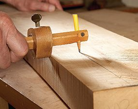 Using a marking gauge with a hole drilled in it to accept a pencil.
