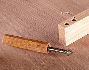 Hand-powered countersink bit.