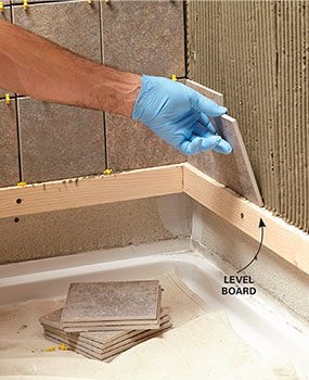 Make tile plumb and level by starting from a level board.