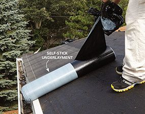 The first step in roofing a house is to nail on the bottom drip edge, then cover it with underlayment.