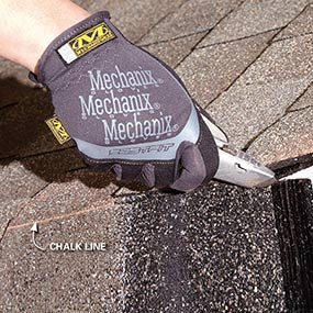 Cut the roofing shingles flush with the edge of the house.