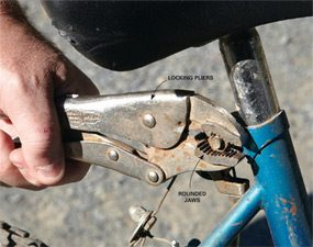 Grip rounded bolt heads with locking pliers.