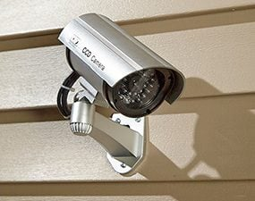 Enhance your home security system with video cameras. A tip: they don't have to be real.