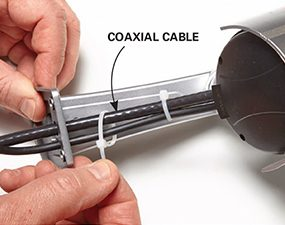 Make fake home security cameras look real with this tip: add fake coax cables.