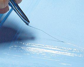 Keep freshly painted doors hair- and bug-free with tweezers.
